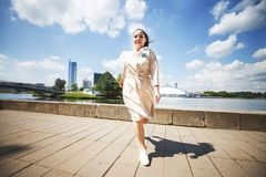 Girl is jumping on a sunny day in the city. girl walking around the city royalty free stock image