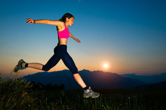 Girl jumping at sunset Royalty Free Stock Images