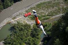 The girl is jumping swallow type from 69 metres height in the SK Stock Image