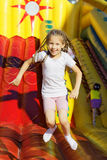 Girl jumping on the trampoline Stock Image