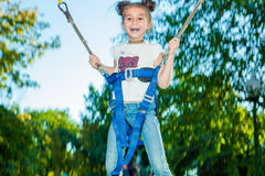 Girl jumping on a trampoline Royalty Free Stock Images
