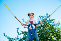 Girl jumping on a trampoline Royalty Free Stock Image