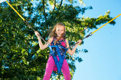 Girl jumping on a trampoline Stock Photos