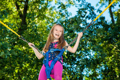 Girl jumping on a trampoline Royalty Free Stock Photo