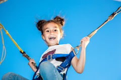 Girl jumping on a trampoline Stock Photography