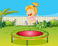 A girl jumping on a trampoline Royalty Free Stock Image