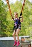 Girl jumping on a trampoline kangaroo Stock Photo
