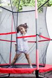 Girl jumping in the trampoline Royalty Free Stock Photography