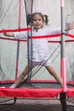 Girl jumping in the trampoline Royalty Free Stock Image