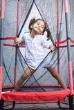Girl jumping in the trampoline Royalty Free Stock Photo