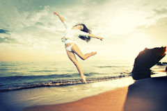 Girl jumping on a tropical beach Stock Photography