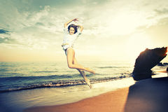 Girl jumping on a tropical beach Royalty Free Stock Images