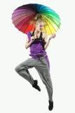 Girl jumping with umbrella Stock Photos