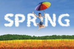 Girl jumping with umbrella Stock Photo