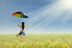 A girl jumping with umbrella Royalty Free Stock Images