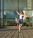 Girl jumping in urban space Royalty Free Stock Photography