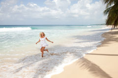 Girl jumping in the water Stock Photo