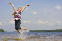 Girl jumping in water Royalty Free Stock Image