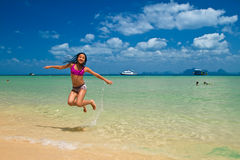 Girl jumping in the water at the beach of the Koh Ngai island Th Royalty Free Stock Photo