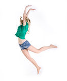 Girl jumping on white background Royalty Free Stock Photos