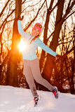 Girl jumping in winter park Stock Image