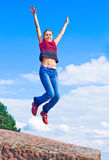 Girl jumps Stock Image