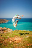 Girl jumps in the air. At the coast royalty free stock images