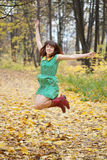 Girl jumps in autumn Royalty Free Stock Images