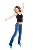 Girl jumps with happiness. Stock Photo
