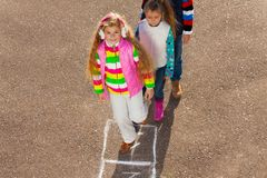 Girl jumps on on hopscotch Stock Photos