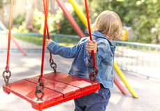 Girl jumps or jumps on a swing Royalty Free Stock Image
