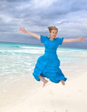 Girl jumps on an ocean coast Royalty Free Stock Photos