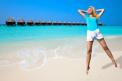 The girl jumps on an ocean coast, Maldives Royalty Free Stock Image