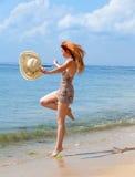 The girl jumps on an ocean coast.Portrait Stock Photography