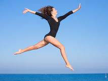Girl jumps on open air Stock Photos
