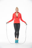 Girl jumps with skipping rope Stock Images