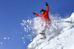 The girl jumps in a snowdrift Royalty Free Stock Photos