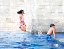 Girl jumps in the swimming pool Stock Photography
