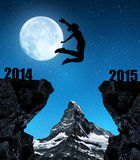 Girl jumps to the New Year 2015 Stock Photography