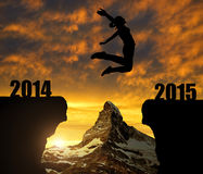 Girl jumps to the New Year 2015. In the background mount Matterhorn Stock Photos