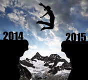 Girl jumps to the New Year 2015. In the background mount Ober Gabelhorn royalty free stock image