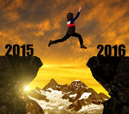 Girl jumps to the New Year 2016. At sunset royalty free stock image