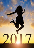 Girl jumps to the New Year 2017. At sunset Royalty Free Stock Photo