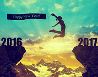 Girl jumps to the New Year 2017 Stock Photography