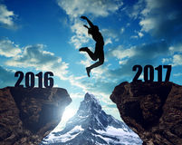 Girl jumps to the New Year 2017 Stock Image