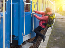 The girl jumps into the train. Stock Images