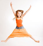 Girl jumps on white background Royalty Free Stock Photography