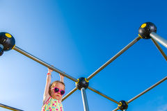 Girl and jungle gym Stock Photography