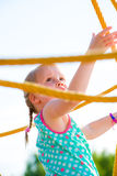 Girl and jungle gym Stock Image