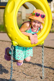 Girl and jungle gym Stock Images